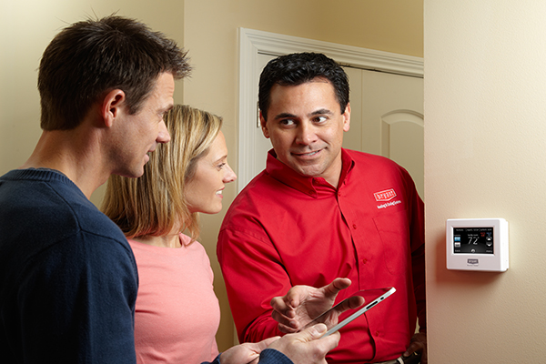 Bryant Heating and Cooling Tech showing homeowner thermostat controls